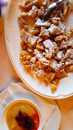 Kaiserschmarrn- basically it's a pancake cut into pieces, but. every one of them is covered in caster sugar and is meant to be dipped in a marmelade made of the local fruits, mostly plums. Austrian Food, Austrian Recipes, Pancake, Dips, Curry, Restaurant, Sugar, Fruit, Breakfast