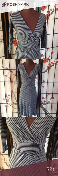 Gilli Midi Faux Wrap Dress, Small, 3/4 Sleeves Super cute stretchy 3/4 sleeve Midi length dress from Gilli. Ruching at the waist on the front and back, with a decorative tie at the back. Size Small. 95% rayon and 5% spandex. Gilli  Dresses Midi
