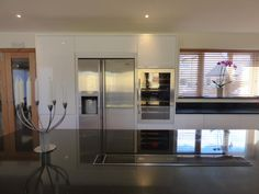 Handleless Remo gloss white kitchen by #secondnature retailer @kitchenflairuk