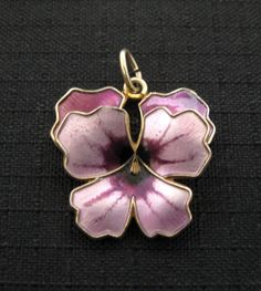 I love anything pansy, and D-A made pins, pendants, and bracelets in this pansy design in several colors and sizes.