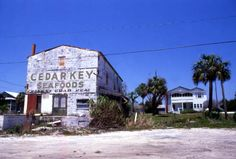 Florida Memory - View showing the abandoned Cedar Key Seafoods building in Cedar Key, Florida 1985 - Opened in 1955 it moved to Otter Creek in 1976