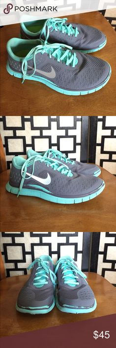 Nike Free Run 4.0 V2 grey and Tiffany blue Very good used condition, cleaned and ready to go. There is some wear around the sides of the shoes where the grey has rubbed off and the blue is showing through. Soles and insoles have minimal wear. Nike Shoes Sneakers
