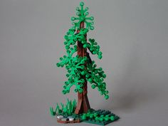 Another tree! A side-ways built trunk, hanging leaves and big roots make it sure a sturdy pine tree. Garden Trees, Trees To Plant, Lego Jurassic Park, Lego Tree, Lego Structures, Micro Lego, Lego Mecha, Lego Castle, Cool Lego Creations