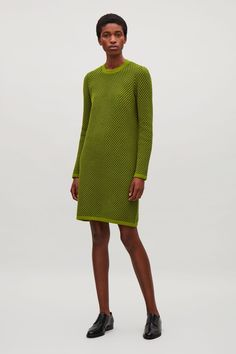 This dress is made from a cotton mix with a textured jacquard stitch. A straight fit, it has narrow shoulders and neat tubular borders at the round neck, cuffs and hem.
