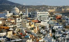 Even if you've never been to this Cyclades island in the Aegean Sea, you'd still recognize it immediately – candy-colored houses carved into cliffs, sapphire waters, gleaming white buildings topped with half-spheres the color of a stormy sky. Fira Santorini, Santorini Hotels, Santorini Island, Fira Greece, Greece Tourism, Greece Travel, Travel Europe, Honeymoon Destinations, Amazing Destinations