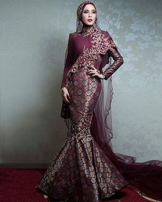 BELLA DALLY wearing a custom marron/rose gold songket dress @bridesbyrizmanruzaini