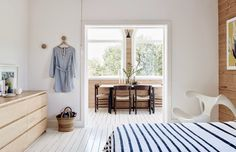 Scandinavian flat of the designer Frag Woodall  in Sydney...   white floors, timbers and Northern Europe des...