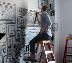 Mural being painted at the Ace Hotel in New York.... do the same but with quotes in frames