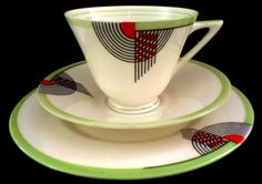 Doulton deco: Tango tea trio, V1484, Rd 776716, c1934 (7). Green colourway - abstract geometric design with black, orange and green highlights on ivory ground and green trim and bands to inner rim. Rare colourway, stunning.