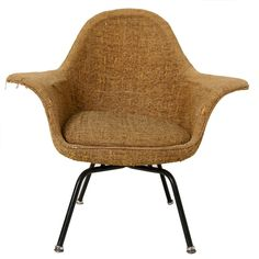 Love the curves of this chair. Needs re-upholstery.