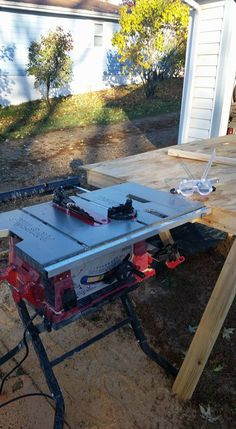 the table saw is wedged to the table  and flat so the parts slide easy. its all level.