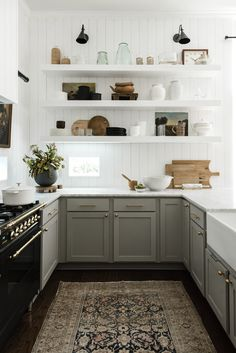 Open white shelving in the kitchen with vintage rugs and black appliances. #kitchendesign Modern Farmhouse Kitchens, Farmhouse Kitchen Decor, Kitchen Interior, Farmhouse Style, Kitchen Design, Home Kitchens, Kitchen Ideas, Interior Design Website Templates, Furniture Decor