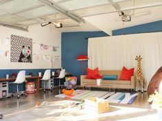Designer Lucie Ayres of 22 Interiors converted this garage into a playroom that can be used in any weather — and by kids of any age. The desk along the wall is perfect for arts and crafts, homework — or a parent who wants to keep an eye on what's going on while catching up on emails.