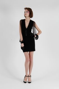 Azzaro RTW. Love the cut out sleeves so very much! The perfect LBD to me.