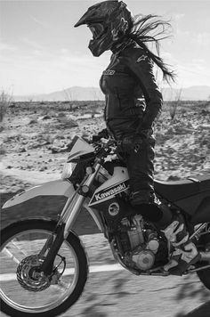 Kerry Ann de la Cruz flying low in Borrego Springs, CA.  Bike: Kawasaki KLX250S Photographer: Lanakila MacNaughton for @WomensMotoExhibit (Instagram)
