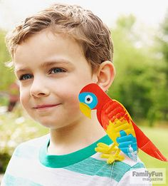 Boy with paper plate parrot on his shoulder