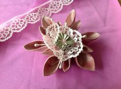 Kanzashi flower with Clover plastic sewing mold, 2 different sizes. Real pink silk, starched and ironed. A bit of lace for the center, silver flower bead and a tiny pink bead. This time I used ready made stems.
