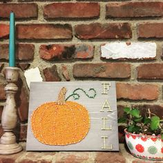 That crisp air is everyday now (yay!!!) and I'm relishing in all my Fall decor. I think I love Fall decorations more than Christmas ones because the colors fit my style better. Orange!!!! I got this beautiful handmade sign from @kiwistrings and it's on prominent display on my mantel. Isn't it beautiful? Go send Kiwi Strings some love and check out her Etsy shop there's so much to like there :)