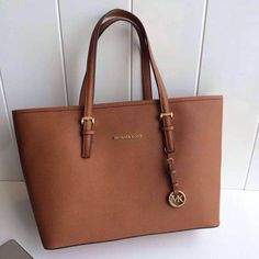 Jet Set Travel Large Saffiano Leather Tote in Luggage, Michael Kors Michael Kors Jet Set, Carteras Michael Kors, Michael Kors Outlet, Handbags Michael Kors, Tote Handbags, Purses And Handbags, Black Handbags, Brown Michael Kors Bag, Michael Kors Tote