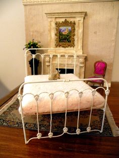 "Dollhouse Miniature 1:12 Scale Artisan Un-dressed Wrought Iron Bed ""Summerwind"". $55.00, via Etsy."