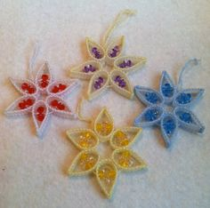 This set of 4 vintage plastic canvas and beaded ornaments are really fun and colorful.  They are put together with yarn to form little stars. Each has a hanger so they can go right on the tree...blue, yellow, red and purple beads decorate each star.  In good condition, they measure about 4 x 4 and are 1/2 high.