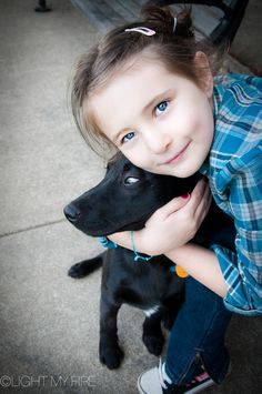 Girl squeezes her dog pet family Charlotte NC Richmond VA by Light My Fire Photography