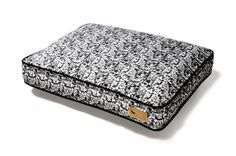 Frolic Rectangular Dog Bed in Black and White. Machine washable and dryer friendly! Easy, comfortable, beautiful and eco-friendly! Available in three colors and three sizes.
