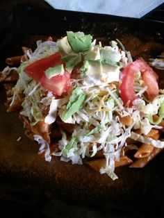 Enchilada Whole Wheat Pasta w/grilled chicken.... Lettuce, Advocado, Tomatoes, Sour Cream, Cheese