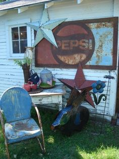 Rusty and Crusty Flea Finds...blue metal lawn chair, chippy white table, old Pepsi sign, &...stars.