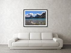 A beautifully framed print over a client's couch. Visit our site for thousands of unique photography and art prints. #homedecor #wallart #interiordesign