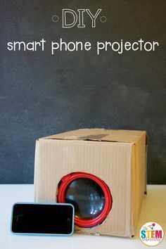 Wondering what to do with your overflowing recycling bin? This oh-so-cool DIY smart phone projector will inspire little engineers to turn recyclables into inventions. There's no stopping the possibilities in a simple cardboard box! Getting Ready To make our DIY smartphone projector, we grabbed: a small cardboard box (ours was 8 inches wide x 6 inches high x 12 inches long) a magnify glass or camera lens scissors,