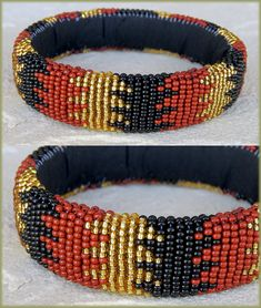 Medium-sized Zulu bangles in GOLD, BROWN & BLACK beads. Traditional African bangles and bracelets handmade by the rural Zulu Beadworkers from South Africa. #africanbeadedbangles #africanbangles #bangles #beadedbangles #africanbeadedbanglessouthafrica #traditionalbeadedbangles #handmadeafricanbangles #ethnicbangles #ethnicbeadedbangles #ethnic #zulubeadedbangles #traditionalbeadedbangles #traditionalafricanbeadedbangles #africanbeadwork #zulubeadwork African Beaded Bracelets, African Beads, Handmade Bracelets, Bangle Bracelets, Bangles, Beaded Christmas Decorations, African Crafts, Zulu, Beadwork