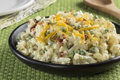Cauliflower Salad: It's a totally loaded potato salad, minus the potatoes. Sub in some tender cauliflower and you've got an absolutely delicious #lowcarb salad!