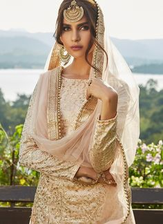 Blush Pink Sequins Embroidered Net Lehenga features a dhupioni silk kameez with santoon inner, net bottom with santoon inner and net dupatta. Embroidery work is completed with sequins and lace embellishments. Pakistani Bridal Dresses, Pakistani Outfits, Indian Dresses, Nikkah Dress, Indian Wedding Outfits, Indian Outfits, 00s Mode, Gold Bridesmaid Dresses, Indian Bridesmaids