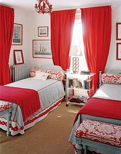 Twin beds. Light blue. Red. White. Sailboats. Lucite. Colored Picture Frames. Natural Fiber Carpet. Benches at Foot of Bed.