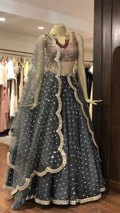 Beautiful Silk Lehenga with golden work embellishments and hand Embroidered blouse and beautiful net dupatta. Silk Lehenga, Anarkali, Lehenga Blouse, Net Saree, Silk Dupatta, Indian Designer Outfits, Designer Dresses, Indian Dresses, Indian Outfits
