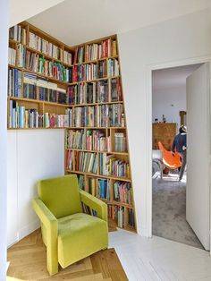 The owners of this apartment wanted to reorganise the interior and make it more open, and so wooden bookshelves were installed within the walls.