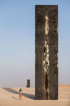 """Sculpture by Richard Serra in Qatar, spreads along the Zekreet desert. """" East- West/ West- East"""" is composed by four major steel structures, more than fourteen meters high each, forming a straight line through the desert, exceeding one km, which is completely according to the land topography."""