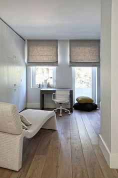 Linen Roman shades in a neutral color. We can help achieve this look in your home - www.budgetblinds.com/southorlando