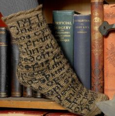 Socks by The Sanguine Gryphon have a portion of the 8th century poem Beowulf on them. Cool.