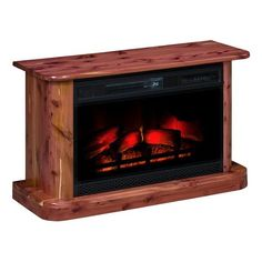 Amish Rustic Cedar Electric Fireplace Enjoy the warmth without the mess. This rustic beauty just plugs right in. Amish made in America. #electricfireplace