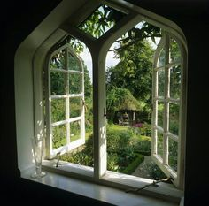 a gothic window onto a garden