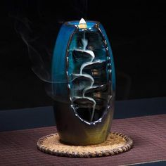 Our splendid, Mountain River Handicraft Incense Holder, Back-Flow Incense Burner has been carefully handcrafted of beautiful, glazed ceramic. When the incense cone is lit, the trail of smoke mimics a waterfall flowing down a mountainside.
