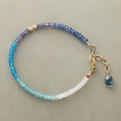 "ADRIATIC BRACELET -- This handmade Thoi Vo gemstone bracelet brightens sea blue gemstones with moonstone ""whitecaps."" Handcrafted in USA with kyanite, iolite, apatite and London blue topaz. 14kt gold filled accents. 7"" to 8""L."