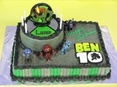 """Ben10 Birthday Cake - Two 6"""" round layers stacked on top of two 9""""x13"""" layers, all chocolate cake covered in buttercream.  The Ben10 logo and the Omnitrix were made out of fondant.  I bought the action figures and candle topper."""