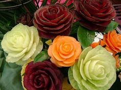flowers made of cut fruit and vegetables