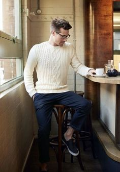 navy pants, a white cable knit sweater and slip ons