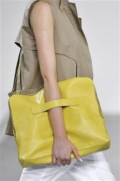 3.1 Phillip Lim  3.1 Phillip Lim    A slouchy, over-sized clutch with a practical strap makes this brightly colored bag perfect to tote around all your essentials and more.