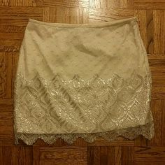 Free People lacey skirt Absolutely gorgeous silver lacey overlay pattern on an offwhite base! Must have piece!! Womens size 8 fits like a 6! Free People Dresses