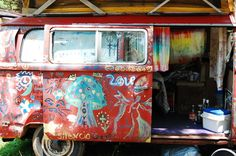 hippie bus interior complete with rainbow curtains
